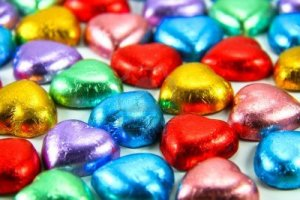 12627938-colorful-foil-wrapped-chocolate-hearts-close-up