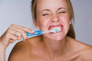 Woman brushing her teeth-1586021